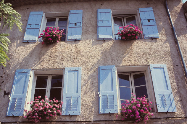 House with blue shutters in 
