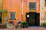 Front view Spanish house with plants and bike