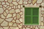 Sierpleister op muur van woning